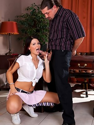 Gorgeous babe in miniskirt fucked in this office by two guys